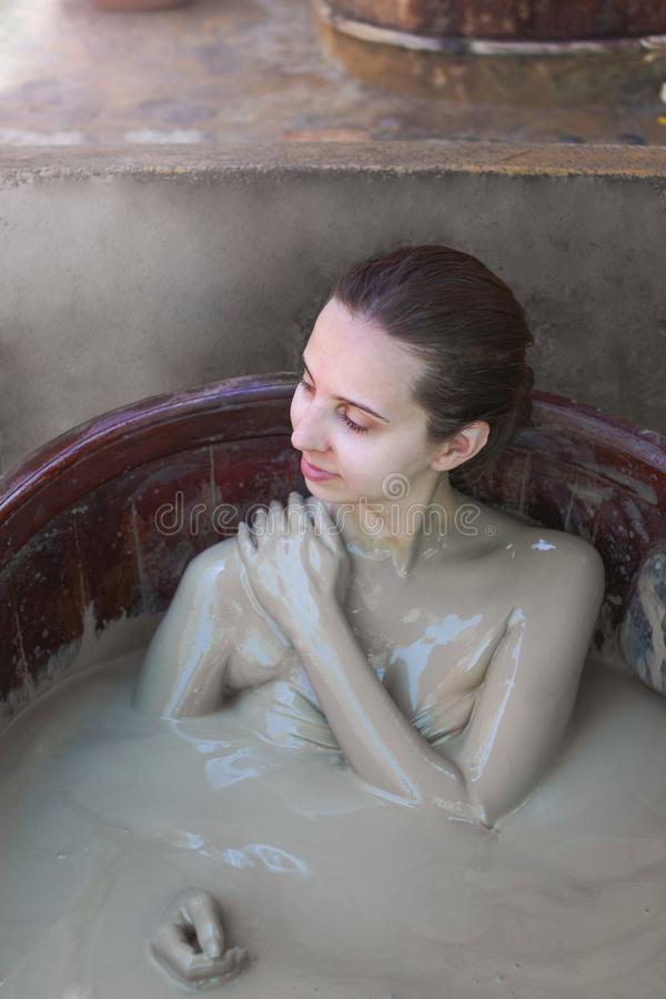 The girl in the mud bath. Concept of relaxation. Nha Trang, Vietnam. royalty free stock image