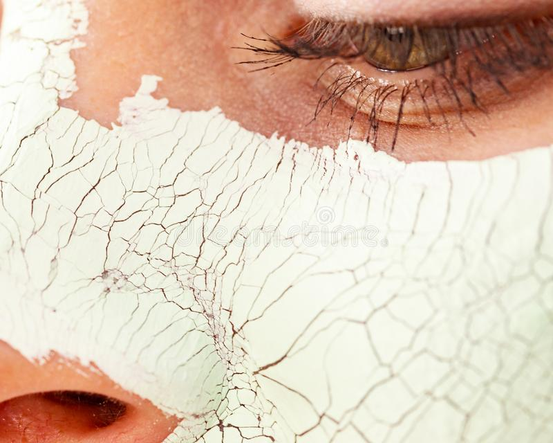 Girl with mud mask on face royalty free stock photo