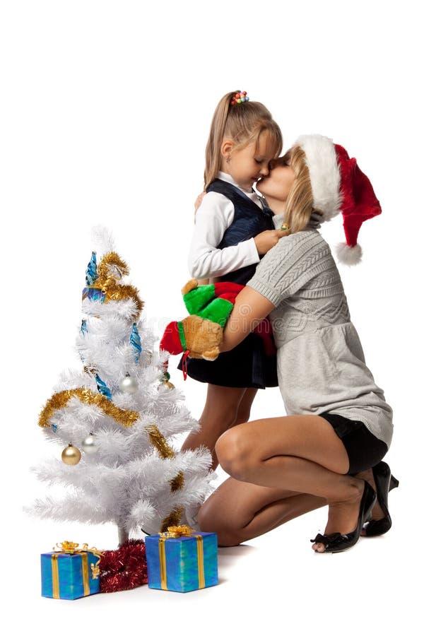 Girl With Mum Decorates A Christmas Tree Stock Photos