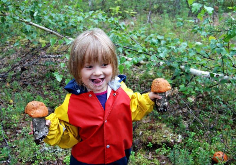 Girl and mushrooms stock photos