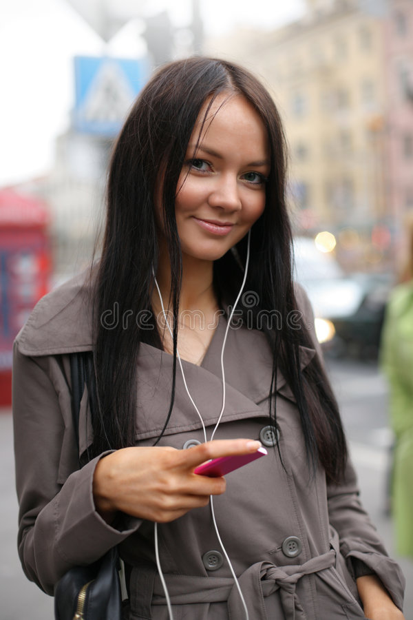 Girl with music player royalty free stock image