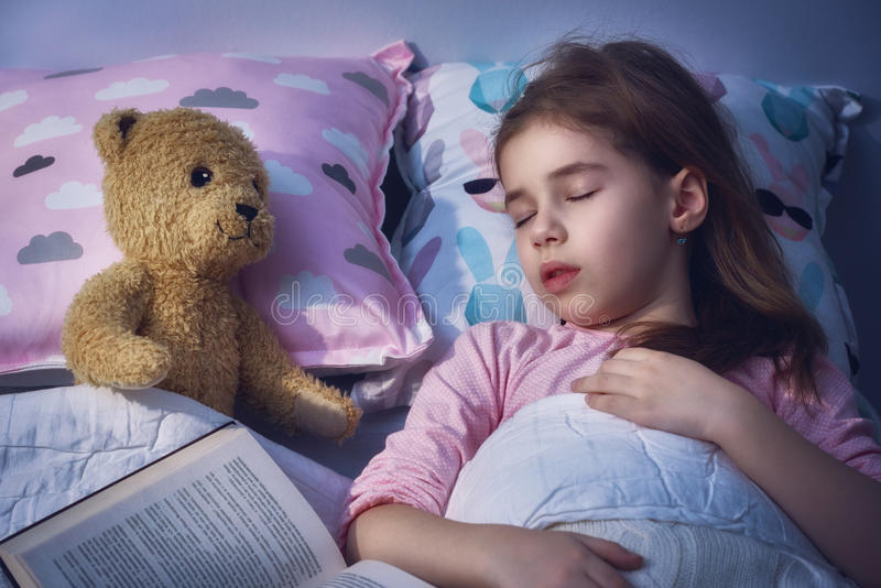 Girl is napping in the bed royalty free stock photos