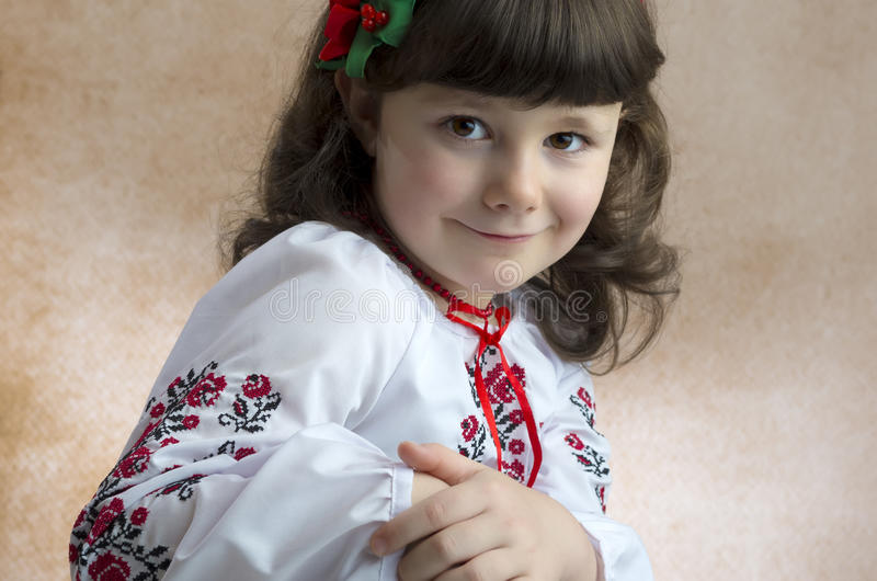 Girl in national costume. Six years old smiling girl in national Romanian costume royalty free stock photos