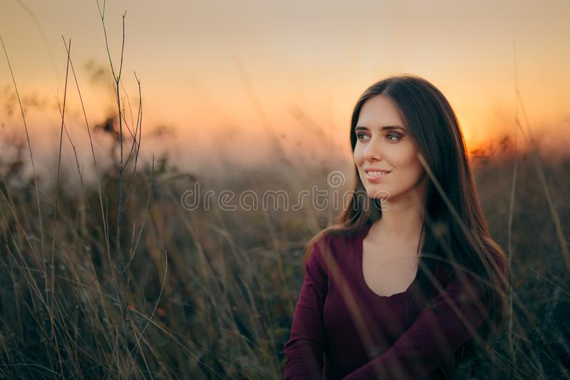 Fashion Portrait of a Happy Woman Admiring Sunset royalty free stock photo