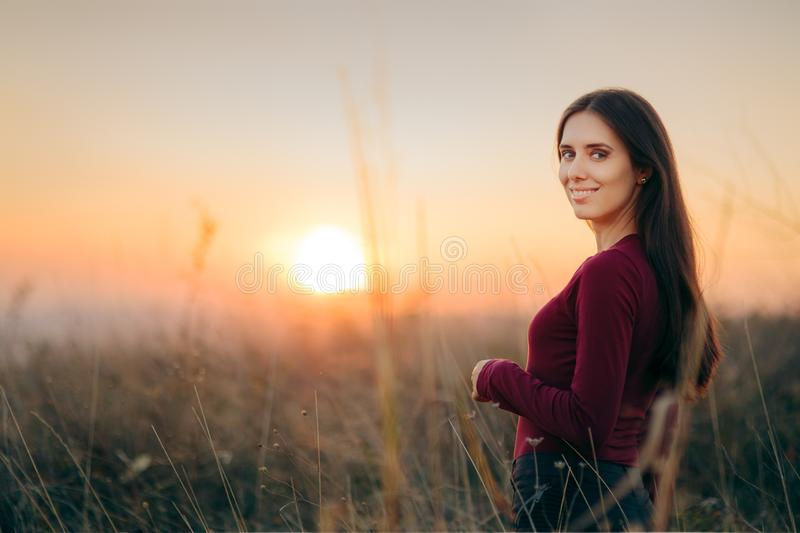 Fashion Portrait of a Happy Woman Admiring Sunset royalty free stock image