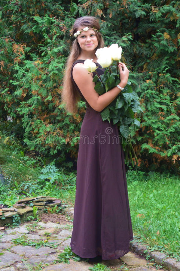 Girl on nature with flowers stock photography