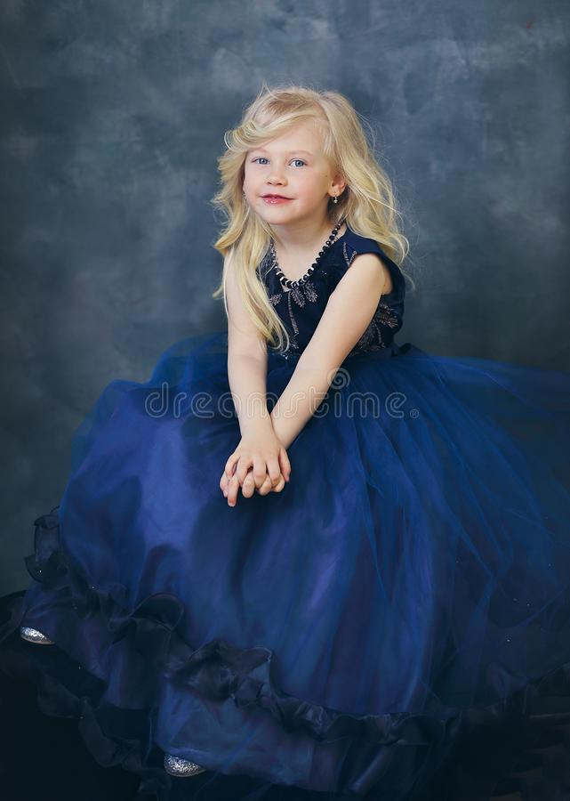 Girl in navy blue dress stock photography
