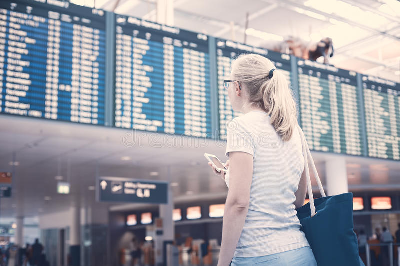 Girl near airline schedule royalty free stock image