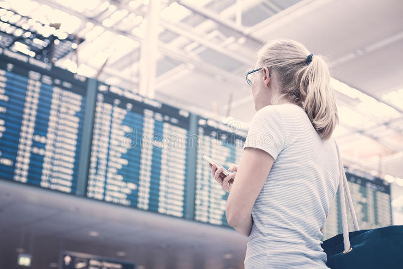 Girl near airline schedule royalty free stock photo