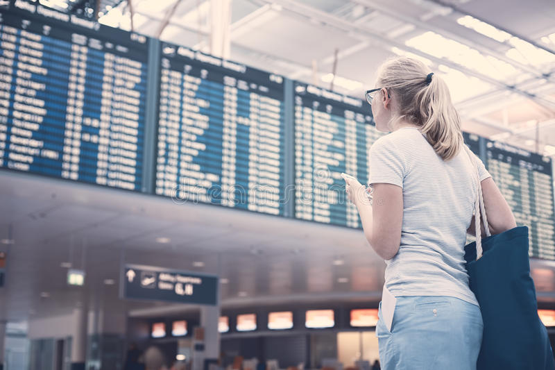 Girl near airline schedule stock images