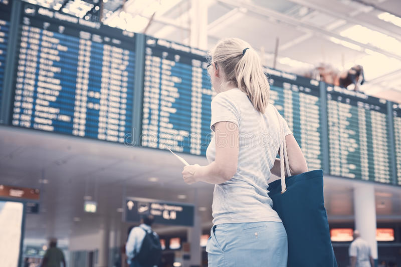 Girl near airline schedule stock photos