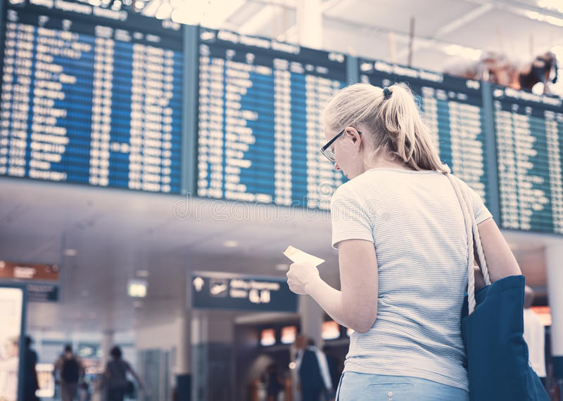 Girl near airline schedule stock image