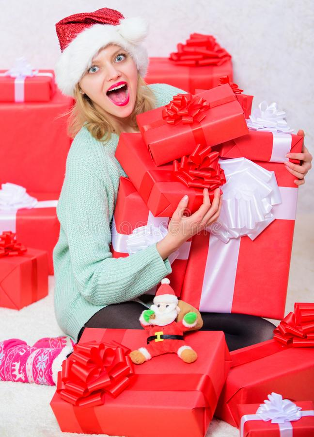 Girl near christmas tree happy celebrate holiday. Woman excited blonde hold gift box with bow. Perfect gift for. Girlfriend or wife. Opening christmas gift stock photography