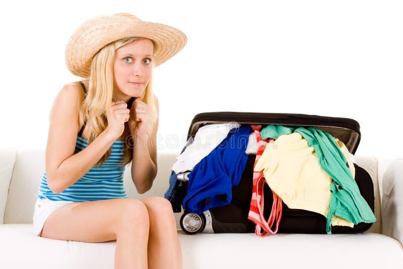 Girl Near Overstuffed Suitcase Stock Photos