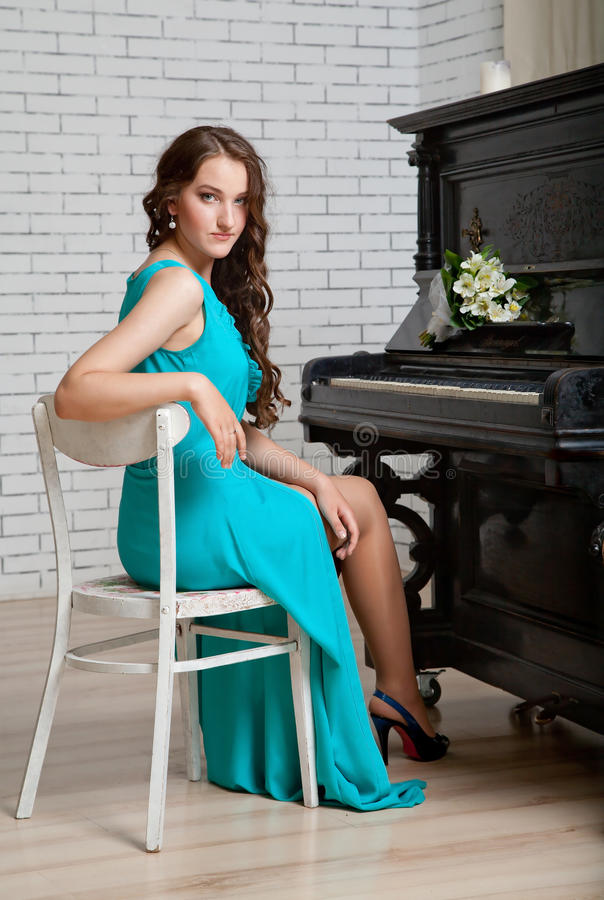 Girl near piano royalty free stock images