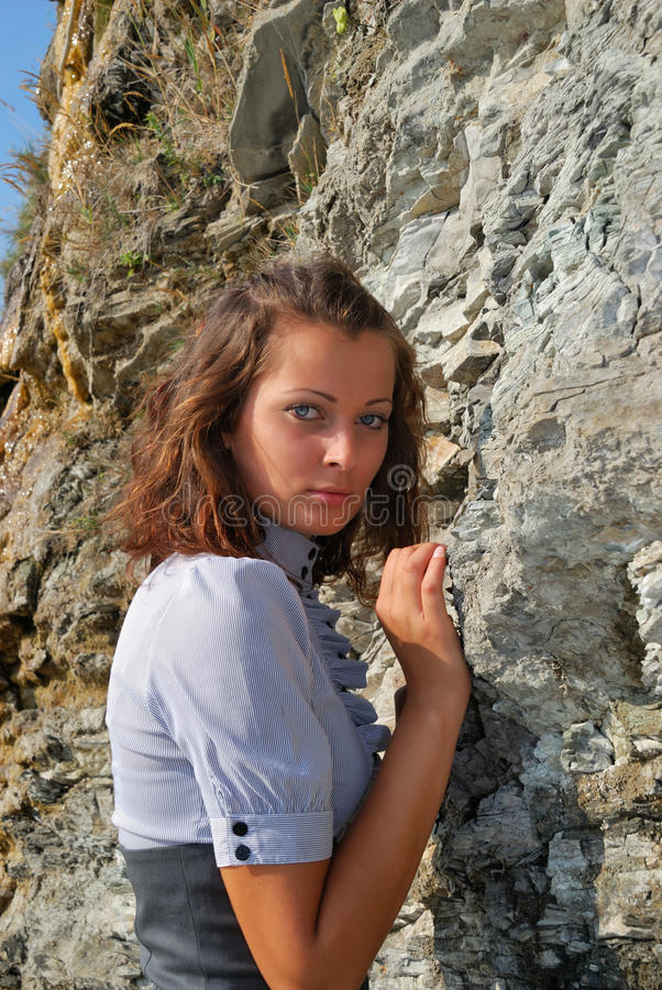 Download The girl near a rock stock photo. Image of hand, hair - 11495916