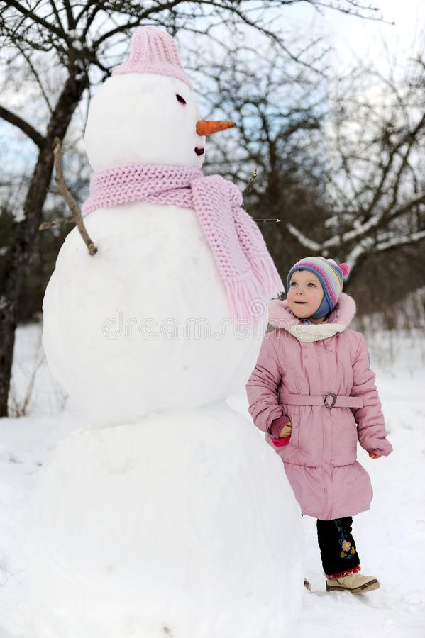 Download Girl Near Snowman Stock Images - Image: 21967034