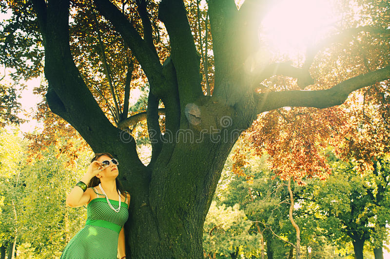 Download Girl Near Tree With Sun Flare Stock Photography - Image: 10351002