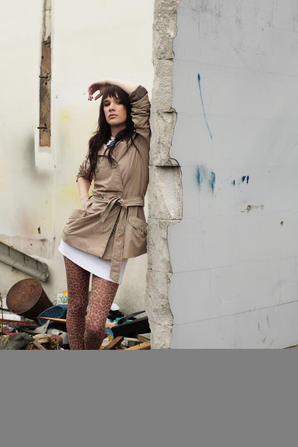 Girl near wall royalty free stock photo