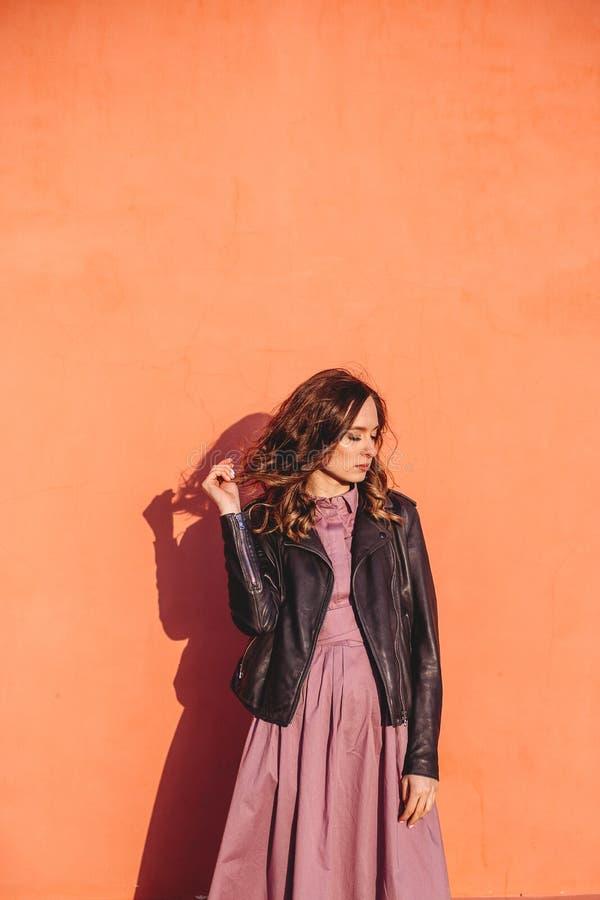 Girl near the wall. stock image