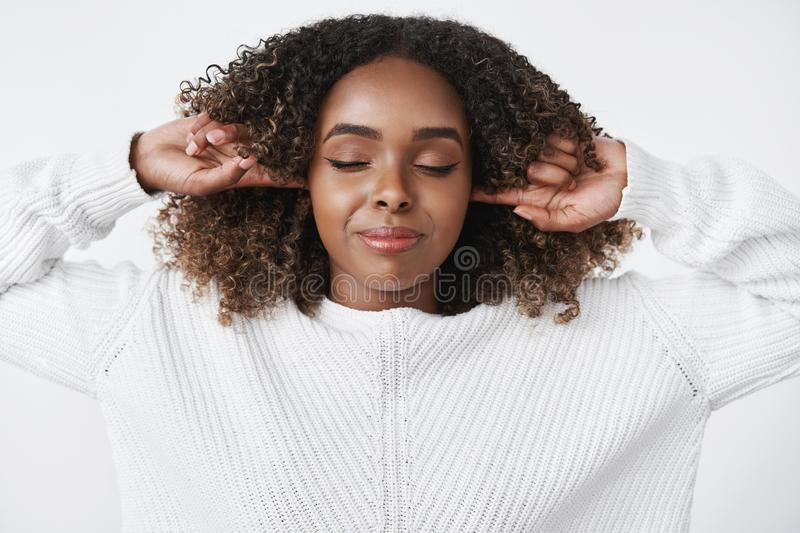 Girl needs silence feeling peace in quiet. Sensual happy and relaxed good-looking woman getting control over emotions stock photo