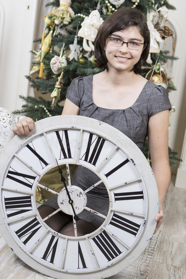 Girl with New Year clock