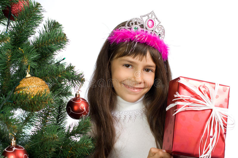 The girl with a New Year tree royalty free stock photo