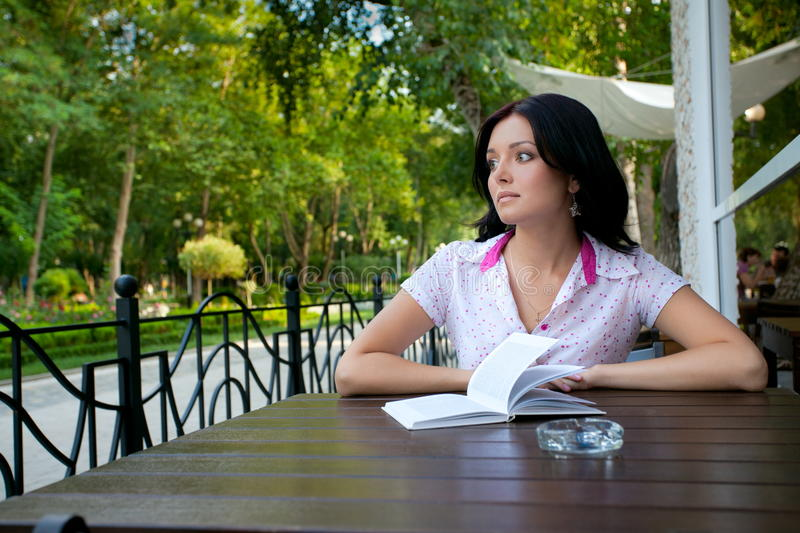 Girl with notepad in cafe stock photo