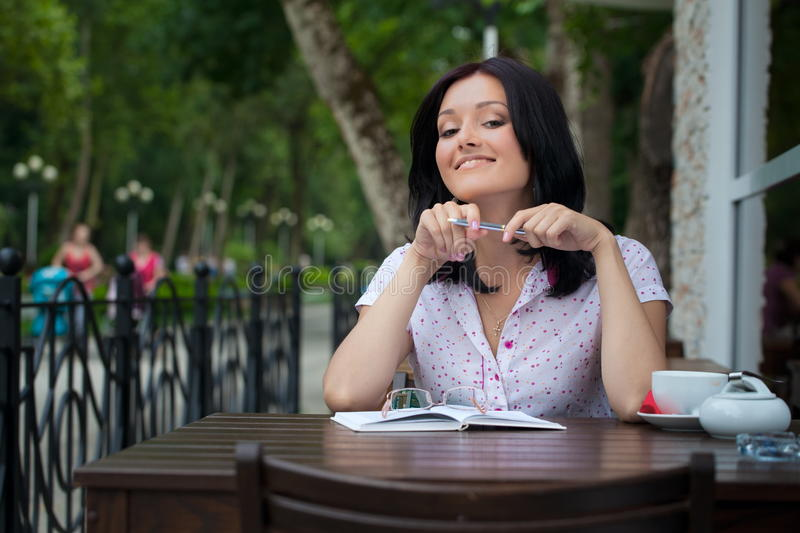 Girl with notepad in cafe stock photography