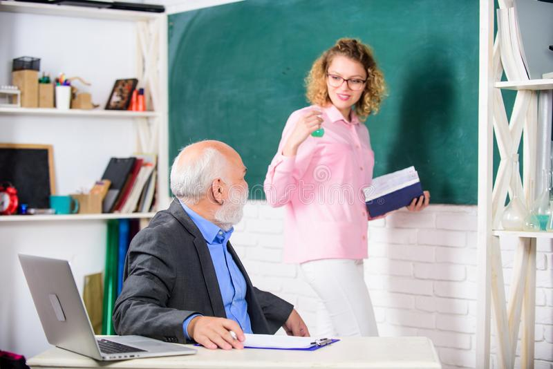 Girl with notepad near chalkboard. High school college university education. STEM concept. Man bearded professor stock photo