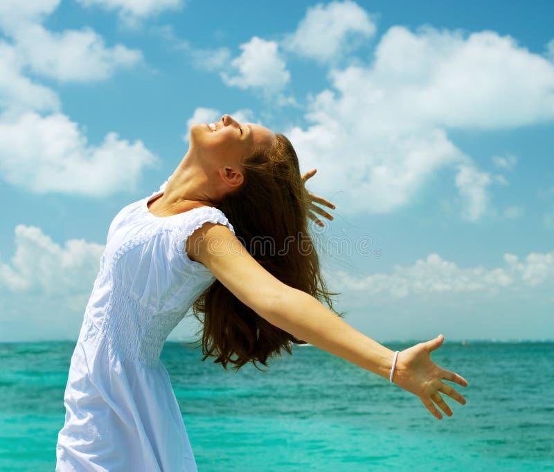 Girl on the Ocean Beach. Travel or Vacation Concept. Beautiful Girl on the Ocean Beach