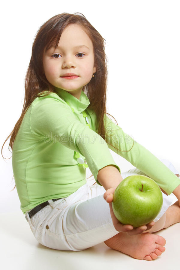 Download A Girl Offering A Green Apple Royalty Free Stock Image - Image: 12840666