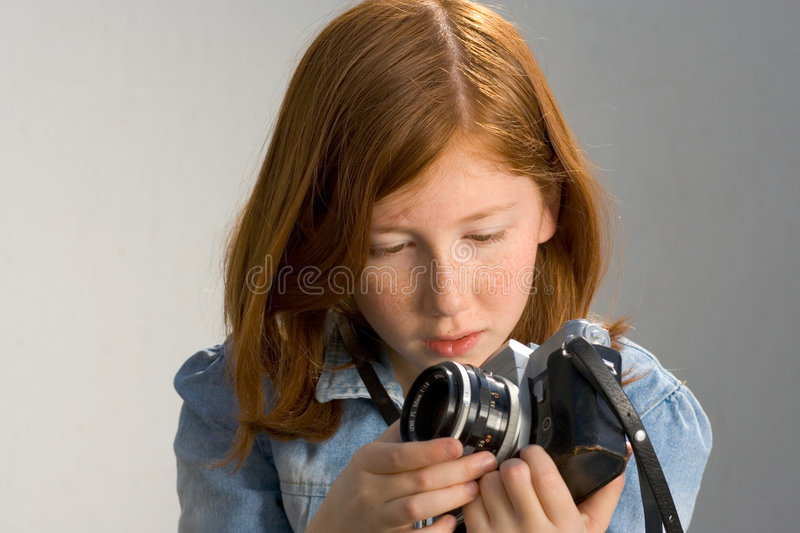 Download Girl With Old SLR Photo Camera Stock Image - Image: 1443627
