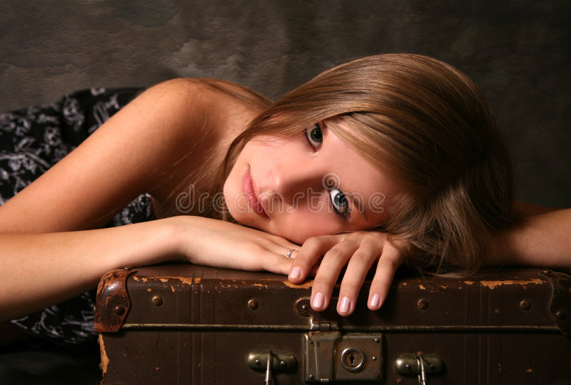 Girl with old suitcase stock image