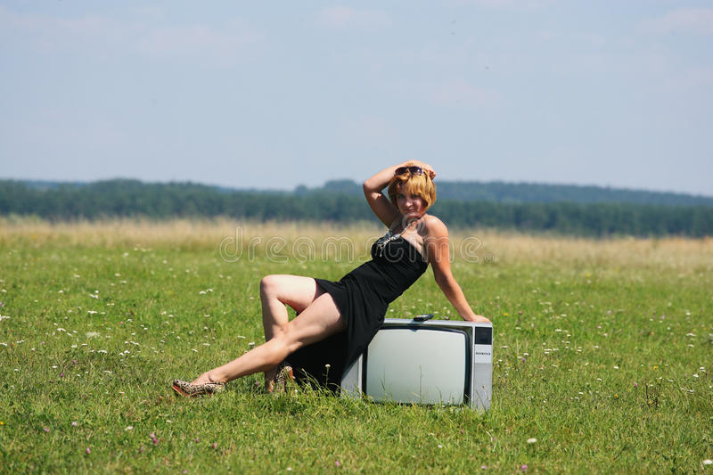 Download Girl With Old Tv At The Middle Of The Fields Stock Photo - Image: 33374110