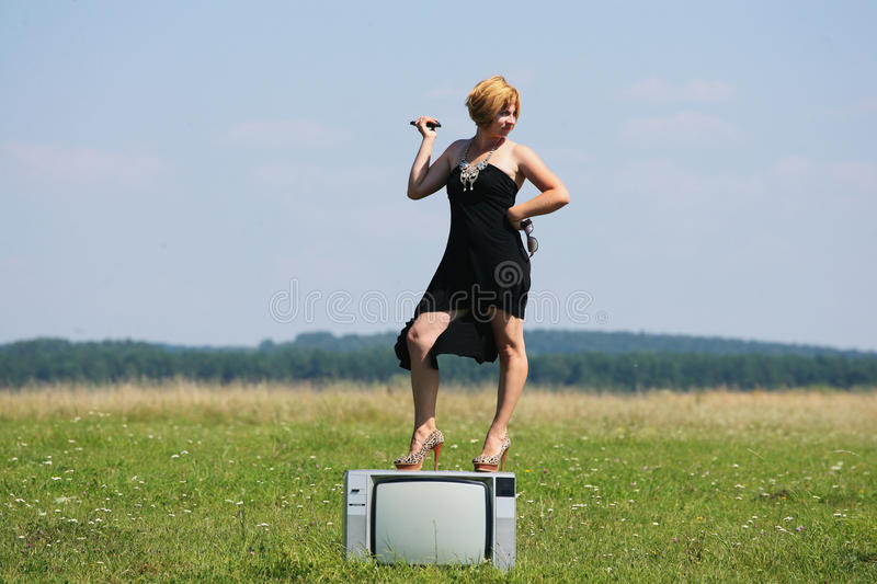 Download Girl With Old Tv At The Middle Of The Fields Stock Image - Image: 33374129