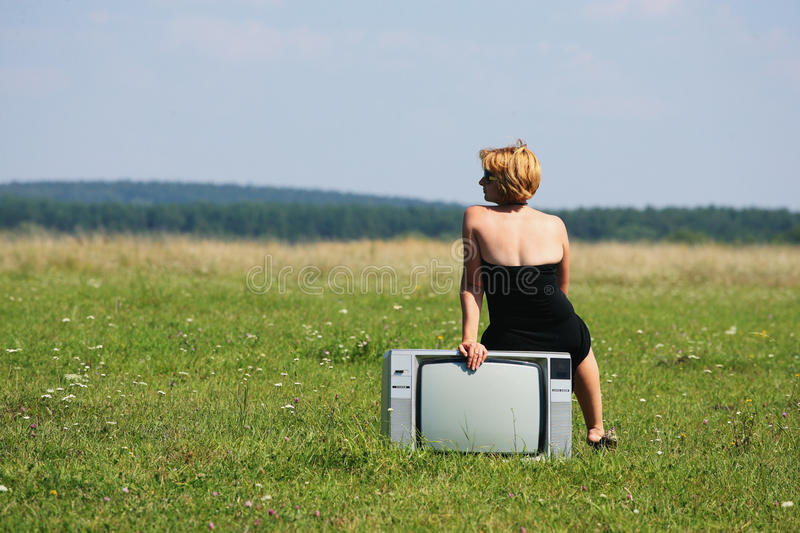 Download Girl With Old Tv At The Middle Of The Fields Stock Photo - Image: 33374196