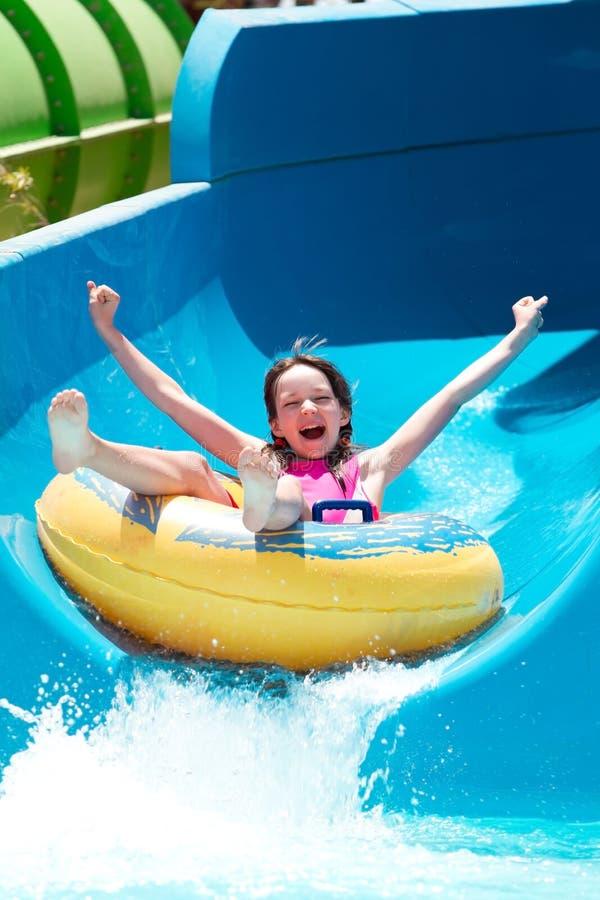 Free Girl On Water Slide Royalty Free Stock Image - 20341616