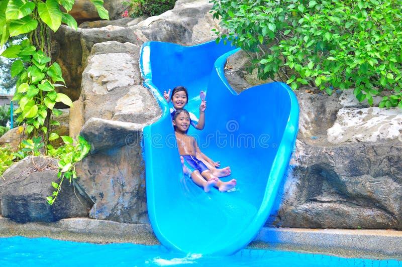 Download A girl ond a boy a slide stock image. Image of enjoy - 20152337