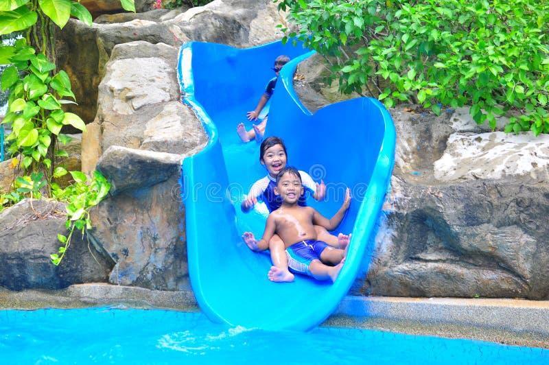 A Girl Ond A Boy A Slide Stock Photo