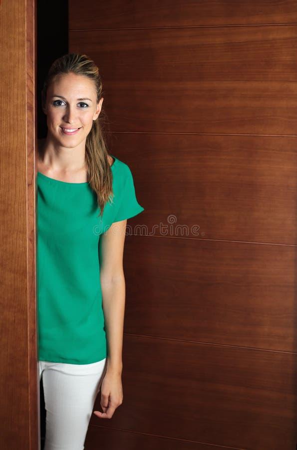 Girl opening door royalty free stock image