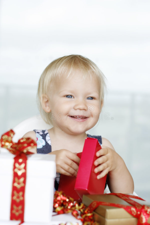 Girl Opening Presents Stock Images