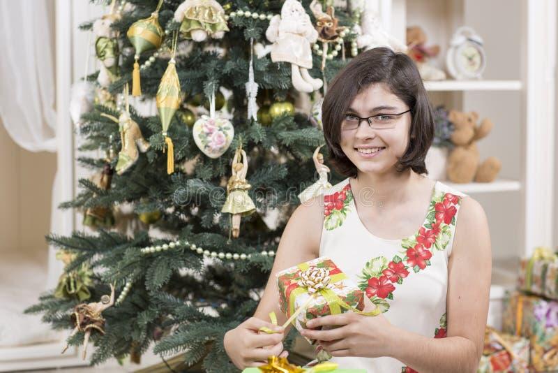 Download Girl opens Christmas gift stock photo. Image of season - 35237712