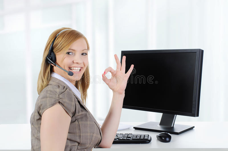 Girl operator at work in the office. royalty free stock photo