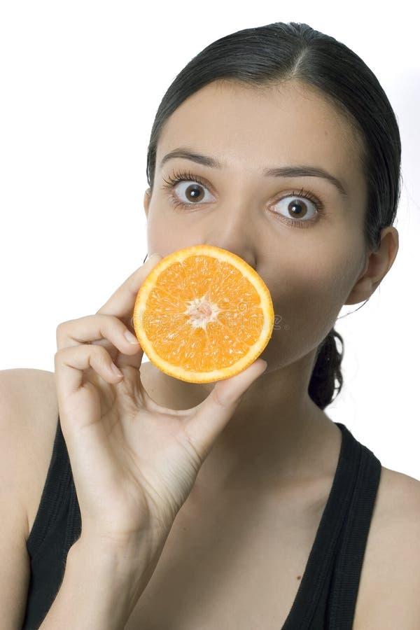 Girl and orange stock photos