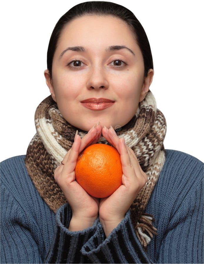 Girl with orange stock photos