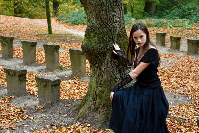 Girl in orange autumn forrest royalty free stock photo