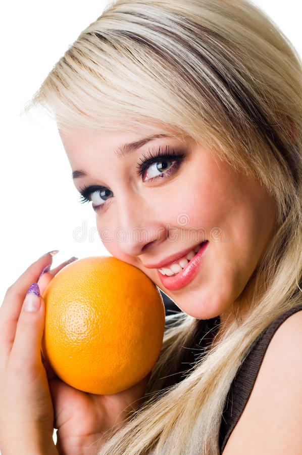 The  Girl With An Orange Close Up Royalty Free Stock Photos