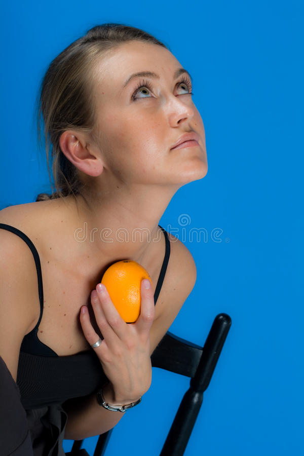 Girl with orange-fruit stock image