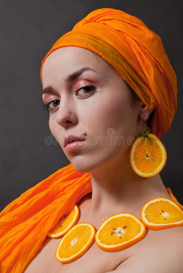 Download Girl with orange headscarf stock image. Image of adult - 18010249